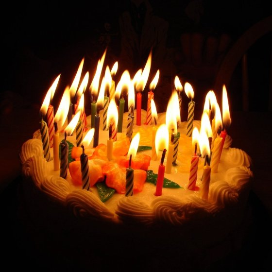birthday_cake_with_lit_candles_by_fantasystock